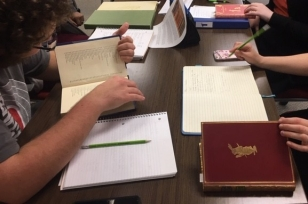 Students in ENGL/WRIT 2223 examining MacDonald Collection books
